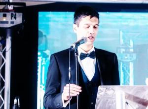 Ibrahim speaks on-stage at the Maa Amar Maa Awards